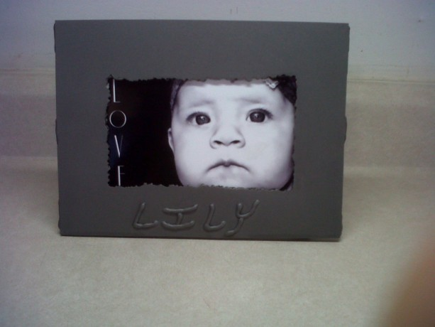 Handmade, customized picture frame. Welded metal, made to order.
