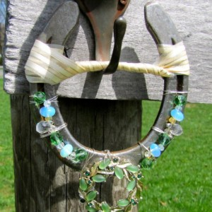 Hand Decorated horseshoe wall hanging. Upcycled, green glass bead, moonstone, horse shoe, recycled, OOAK gift, Good luck charm, housewarming