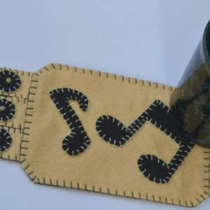 Handmade Penny Rug, Musical Notes, yellow and black Mug Rug