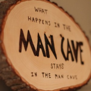 "real wood MAN CAVE sign/plaque with wood burned ""What happens in the man cave stays in the man cave""."