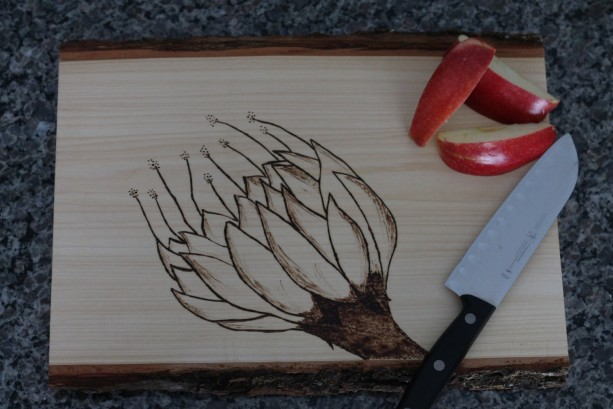 Wooden Cutting board with hand wood burned flower design.