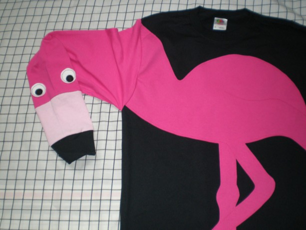 Long sleeve black tee shirt with an appliqued flamingo. Adult size medium