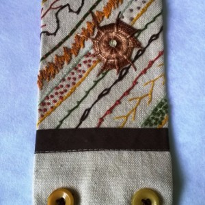 Hand Embroidered Cuff in Earth tones on Linen with Vintage Buttons and a Swarovski Crystal