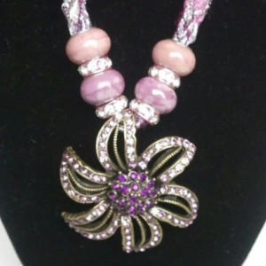 Flower pendant on a hand-knitted cord! Toggle closure, premium glass bead accents, and jeweled accent beads!
