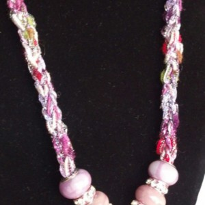 A crystal pendant on a hand-knitted cord! Toggle closure, premium glass bead accents, and jeweled bead accents!