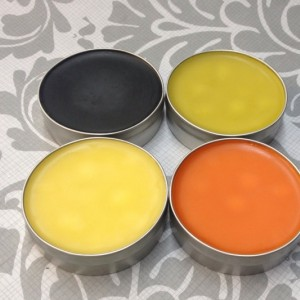 Medium Salve Sample Pack 4- 2 oz Tins: Black Drawing Salve, Muscle and Joint Balm, Mom's Marigold Salve, Comfrey and Calendula Salve