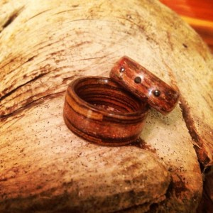 Wedding band set. Zebra wood with gold stone inlay and silky walnut with three black diamonds.