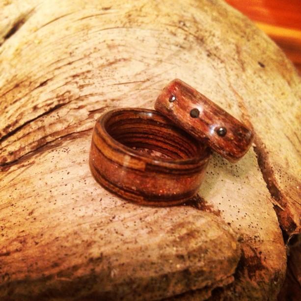 Wedding band set. Zebra wood with gold stone inlay and silky walnut with three black diamonds.