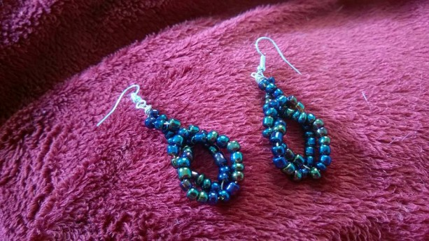 Twisted iradescent blue beaded earrings