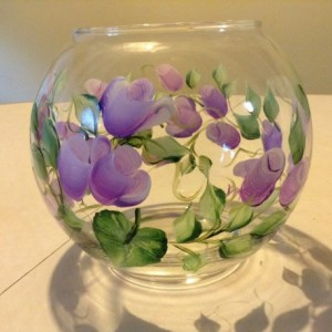 Pretty purple roses with green leaves painted on a round glass bowl style candle holdr