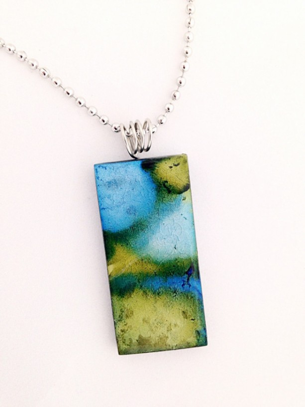 Hand painted blue and green alcohol ink design on glass tile pendant.