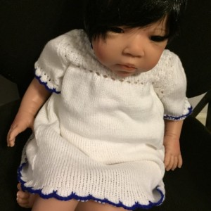 Sweet little white cotton dress for baby