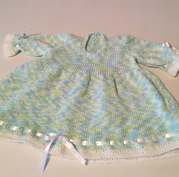 Lovely baby dress in soft spring colors