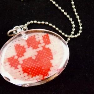Custom, reversible, dog themed resin pendant