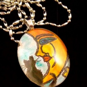 Moon face with black cat sitting on it, pendant necklace