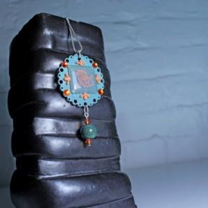 Round Indie teal and orange crystal pendant, plastic flower necklace, aquamarine flower pendant