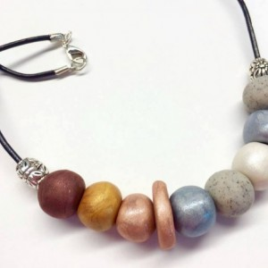 Intergalactic / Metallic shimmer pearl handmade artist grade polymer beaded necklace leather cord sterling silver plated beads and clasp
