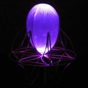Purple LED lit Selenite egg resting on flower of life pedestal