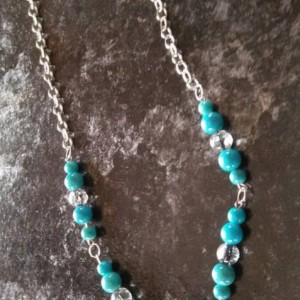 Silver chain necklace with aqua and clear glass beads, 14 inches long.
