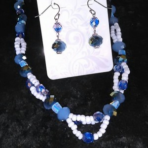 Bluish green glass beads with small blue and white glass beads, 8 inches long with 3 inch silver chain connector and matching earrings.