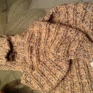 Hand knit baby sweater-zips up the back