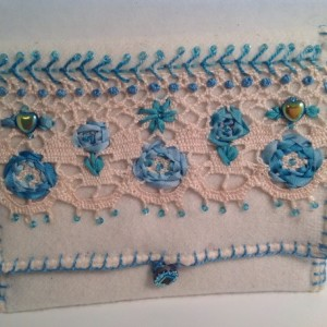 Ivory felted wool wallet with blue silk embroidery