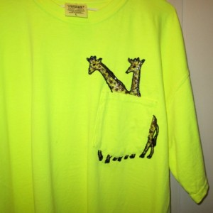 Fluorescent yellow tshirt, hand painted w/ Giraffes running though pocket
