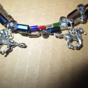 Hand made double strand beaded bracelet with 2-3D sterling silver horse charms