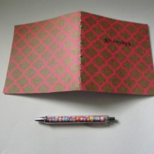 moleskine-style notebook - thoughts - bright pink repeating pattern // handmade/stitched